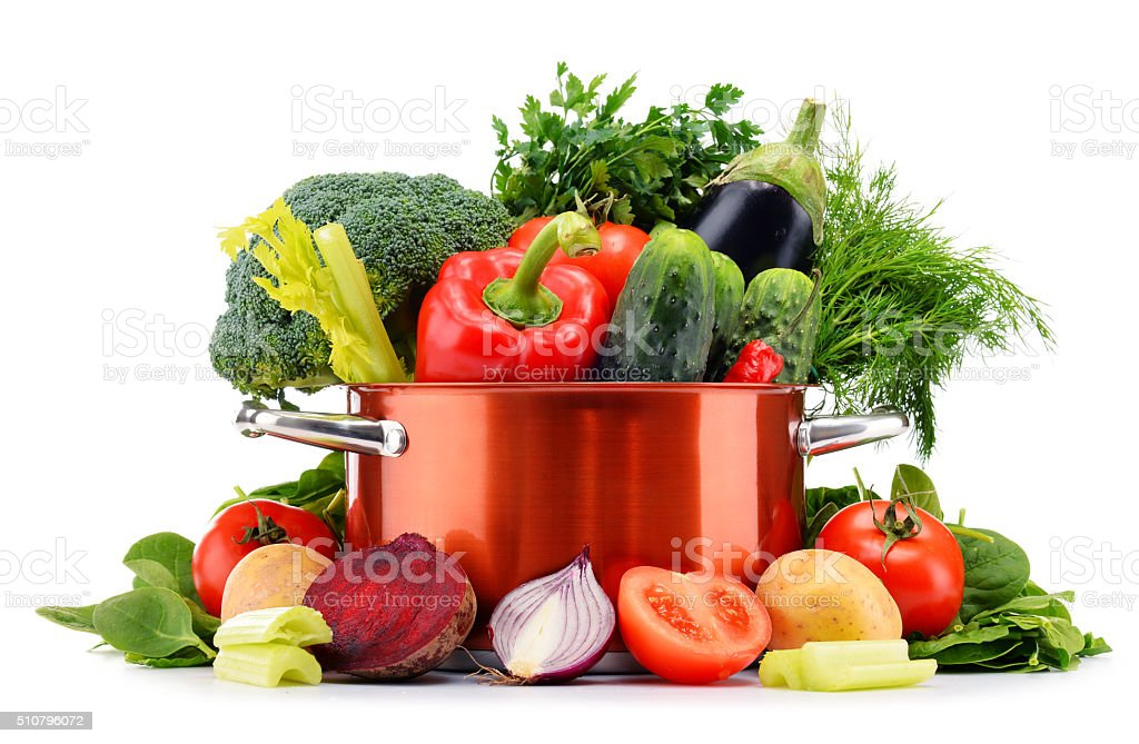 Pot and raw vegetables isolated on white. stock photo