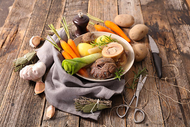 pot au feu,beef stew with broth and vegetable pot au feu,beef stew with broth and vegetable pot au feu stock pictures, royalty-free photos & images