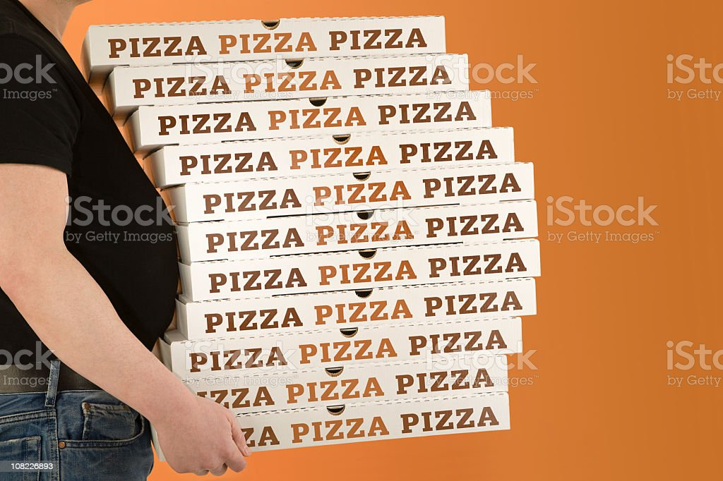 Pot Belly Surrounded by Pizza Box royalty-free stock photo