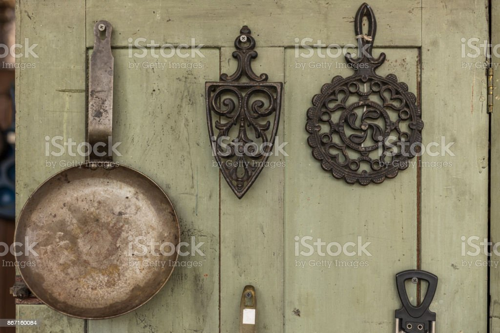 Pot hanging on wooden wall stock photo