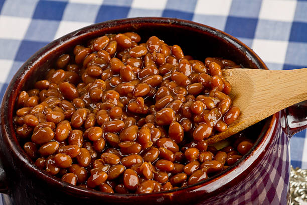 Pot of Baked Beans on a Blue Gingham stock photo