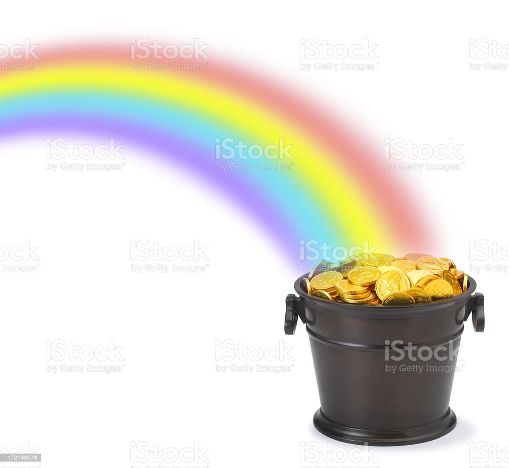 Pot of gold at end of rainbow stock photo