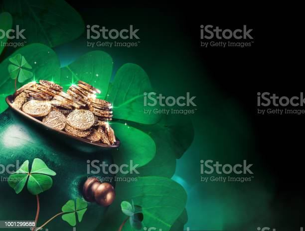 Pot of gold coins with four leaf clovers in the background picture id1001299588?b=1&k=6&m=1001299588&s=612x612&h=ceokyhvzcwsqmnwnuqov1j xtiggb0egkrwvraa8xfy=