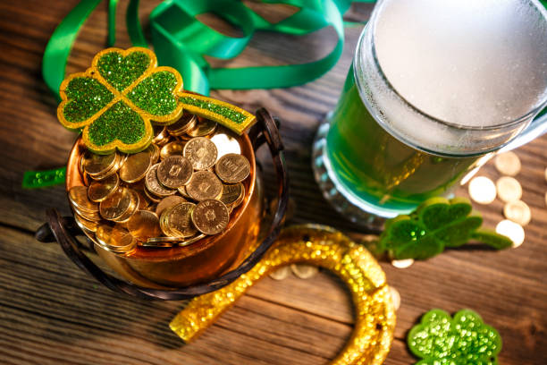 Pot of gold, green beer and shamrocks stock photo