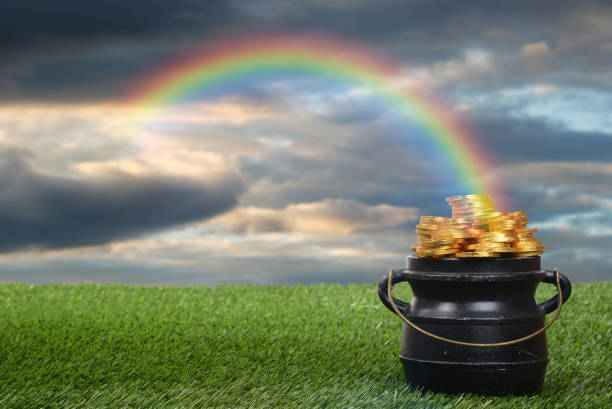 pot of gold with rainbow stock photo