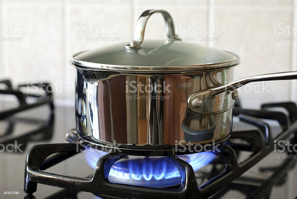 Pot on a gas stove stock photo