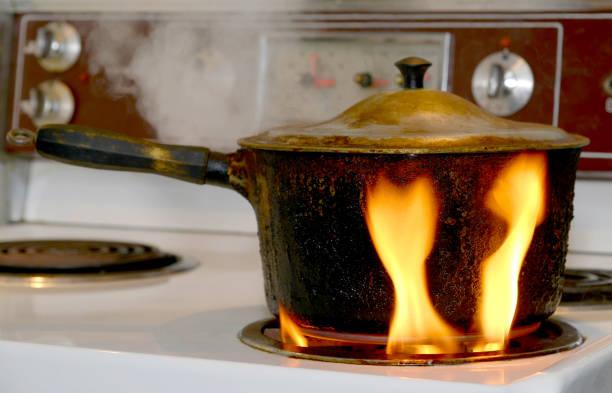 pot on fire on stove - burned cooking imagens e fotografias de stock