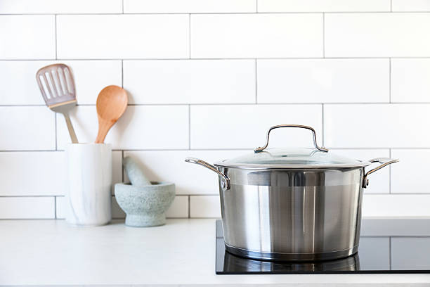 Pot on kitchen induction cooktop – Foto