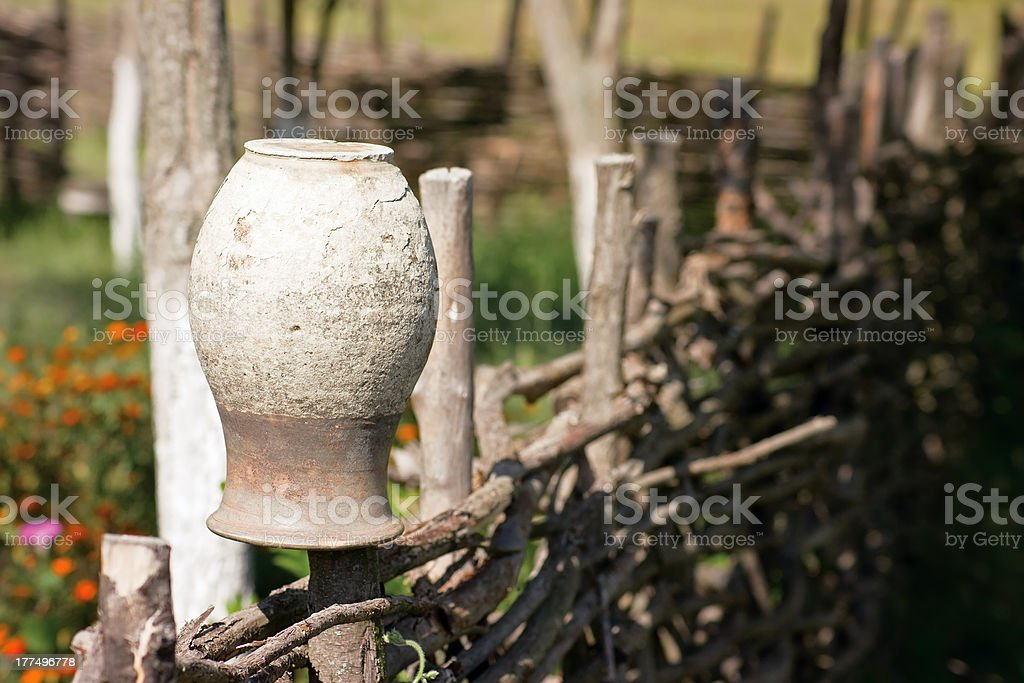 Pot on the fence royalty-free stock photo