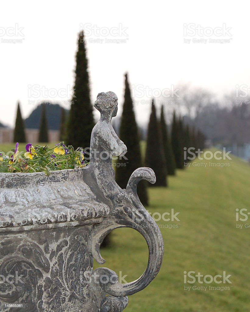 Pot Plant with female statue stock photo