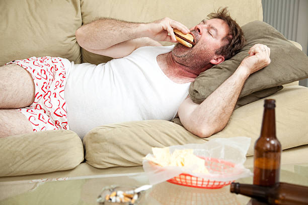 pot smoker with the munchies - laziness stock photos and pictures