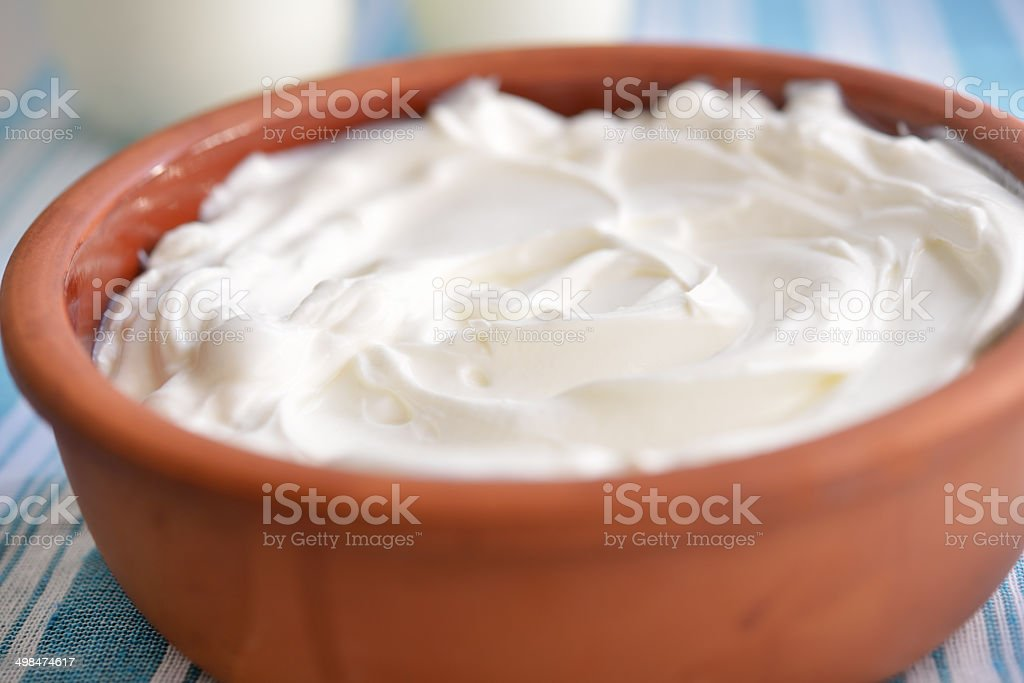 Pot with yogurt stock photo