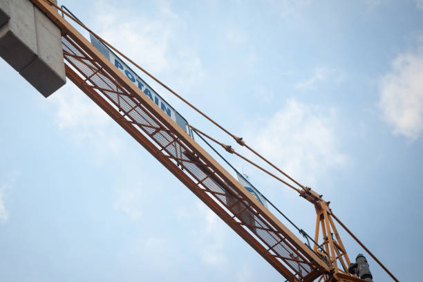 BELGRADE, SERBIA - JANUARY 11, 2020: Potain logo on one of their tower cranes in a construction sign. Potain cranes is an industrial manufacturer part of Manitowoc. BELGRADE, SERBIA - JANUARY 11, 2020: Potain logo on one of their tower cranes in a construction sign. Potain cranes is an industrial manufacturer part of Manitowoc.