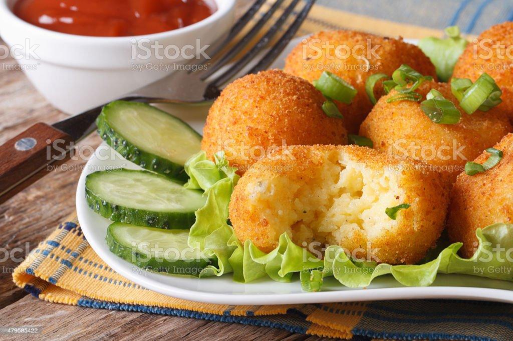Potato balls fried on a plate horizontal stock photo