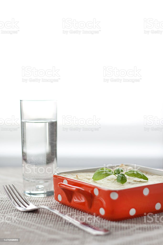 Potato cake with basil leaves on the top stock photo