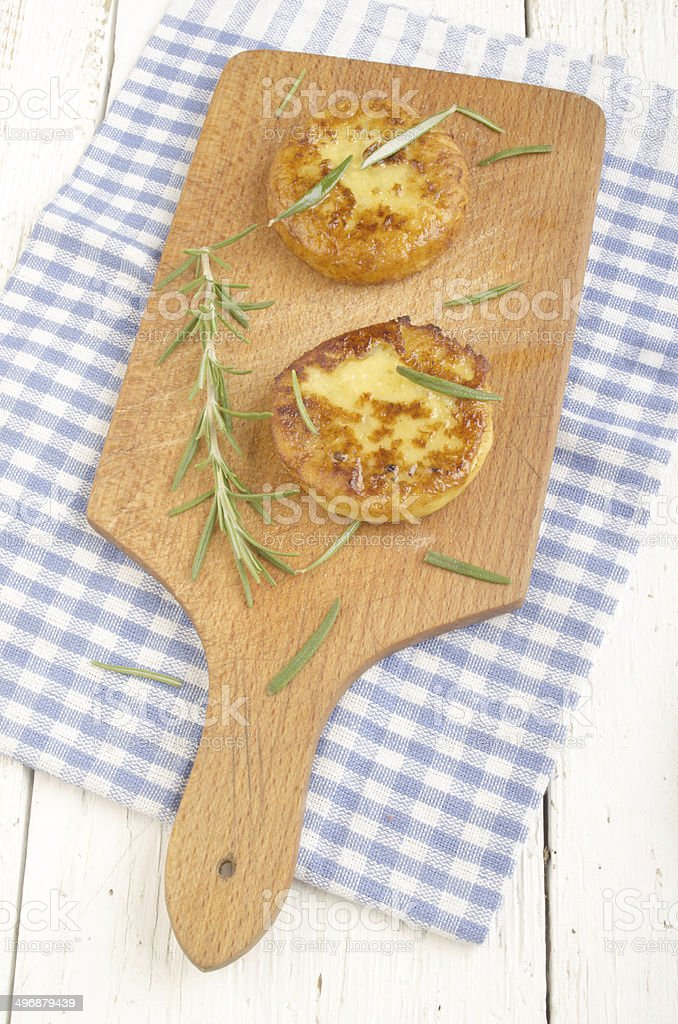 potato cake with rosemary on wooden board stock photo