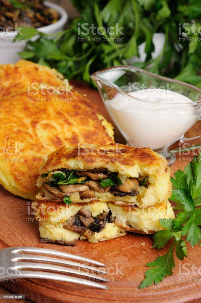 Potato cakes (zrazy) stuffed with mushrooms stock photo