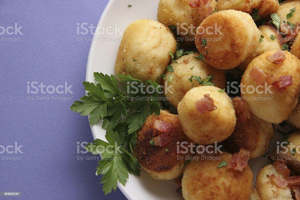 Potato cakes with bacon. royalty-free stock photo