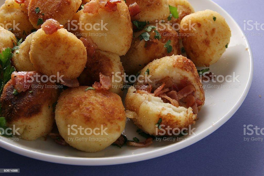 Potato cakes with bacon. stock photo
