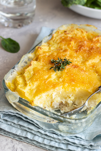 istock Potato casserole with fish and cheese on a light grey background. 1209866003