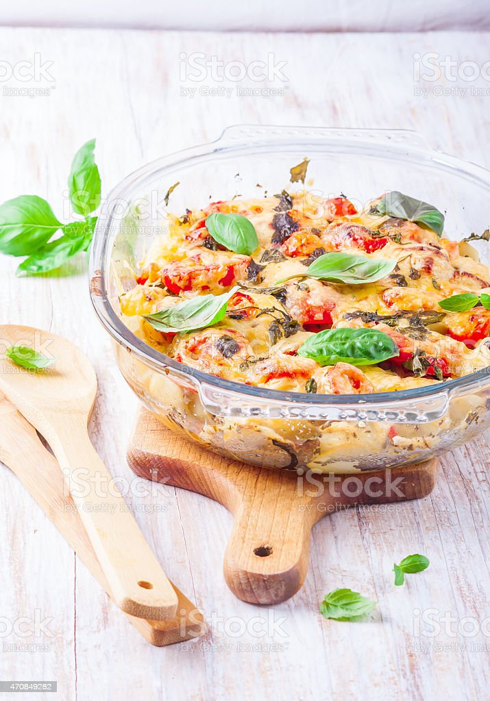 potato casserole with tomatoes and cheese stock photo