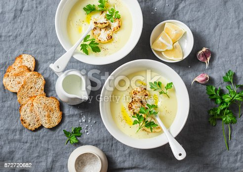 istock Potato cauliflower soup puree on a gray background, top view. Vegetarian healthy food concept 872720682