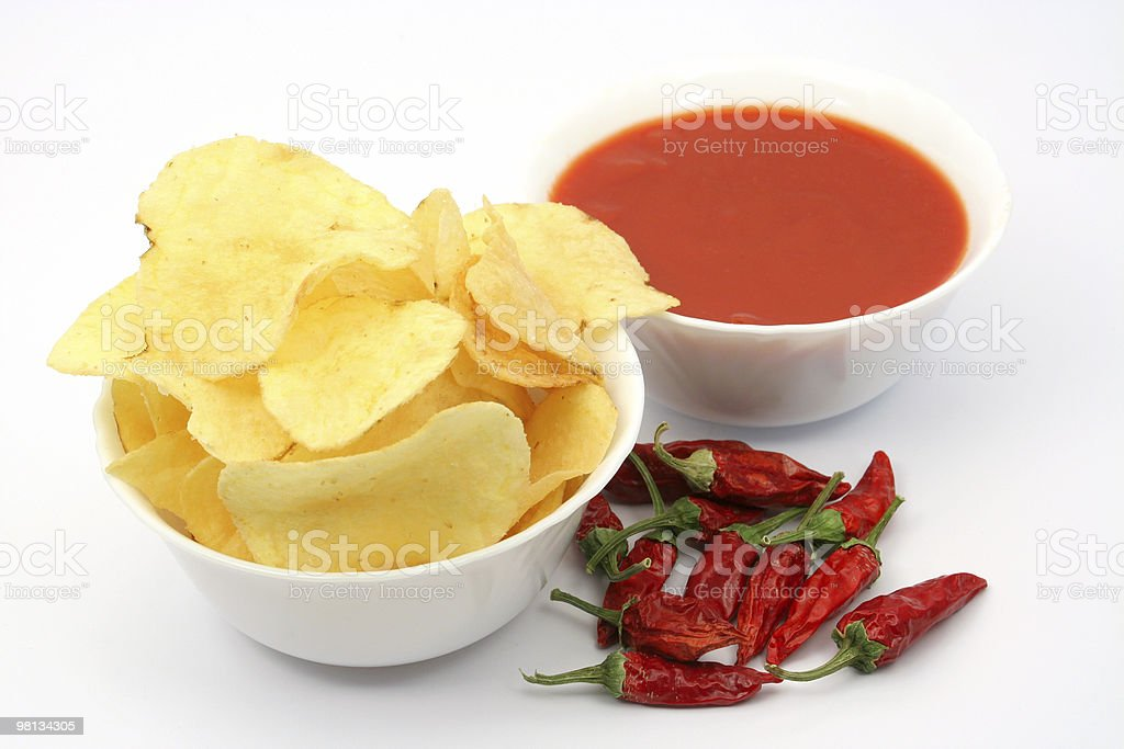 Potato chips and salsa dip royalty-free stock photo