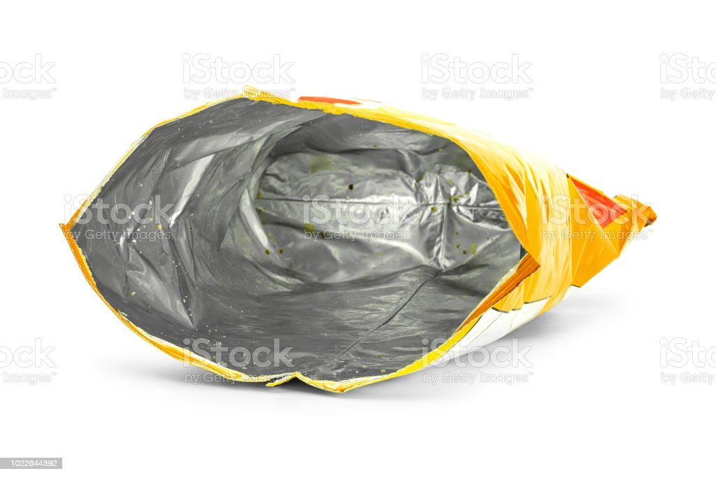Potato chips bag isolated on white background. Inside of leftovers snack packaging. stock photo