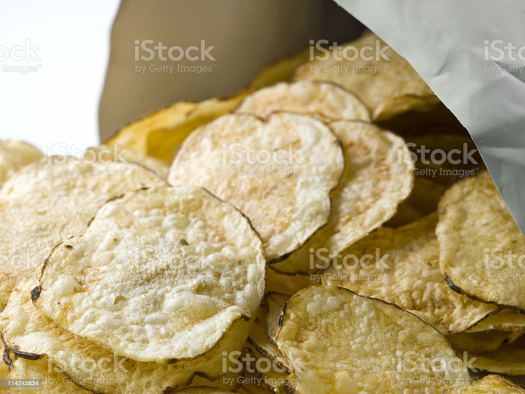 Potato chips coming out of the bag royalty-free stock photo