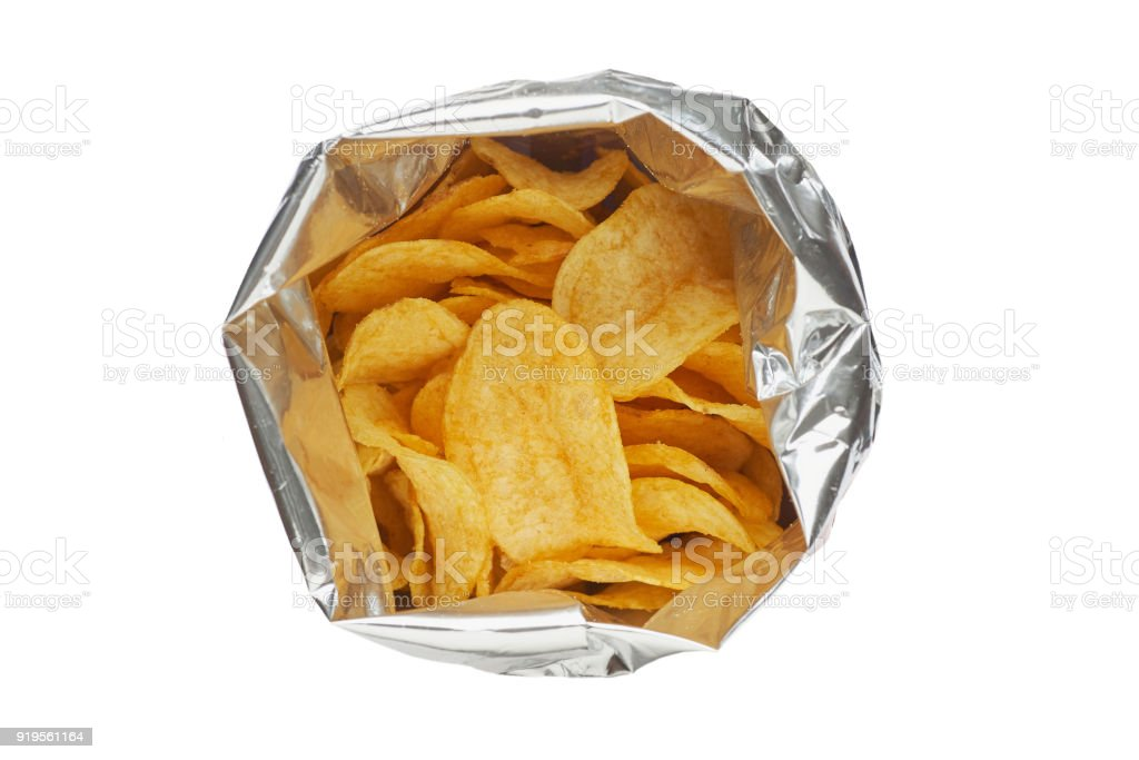 Potato chips in a silver package isolated on a white background close-up. stock photo