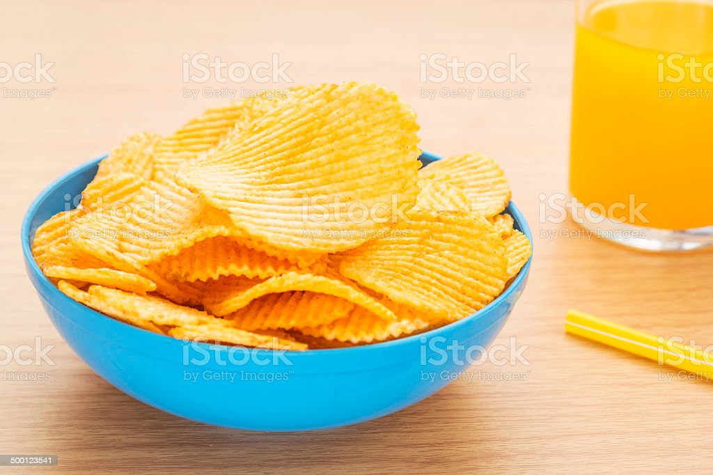 Potato chips in bowl and juice royalty-free stock photo