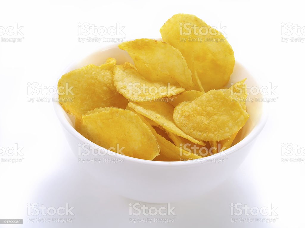 Potato chips in bowl royalty-free stock photo