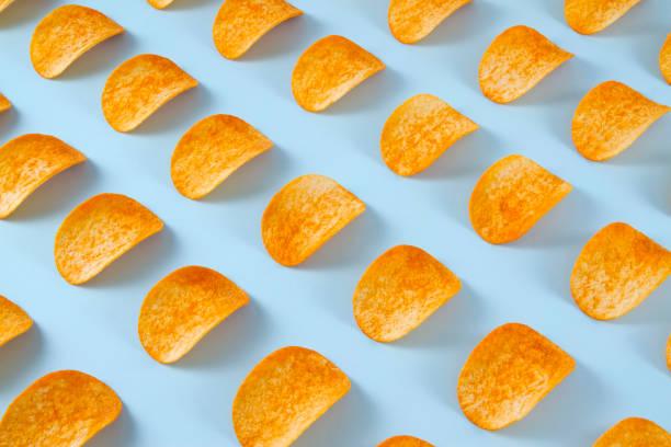 Potato Chips on Blue Background stock photo