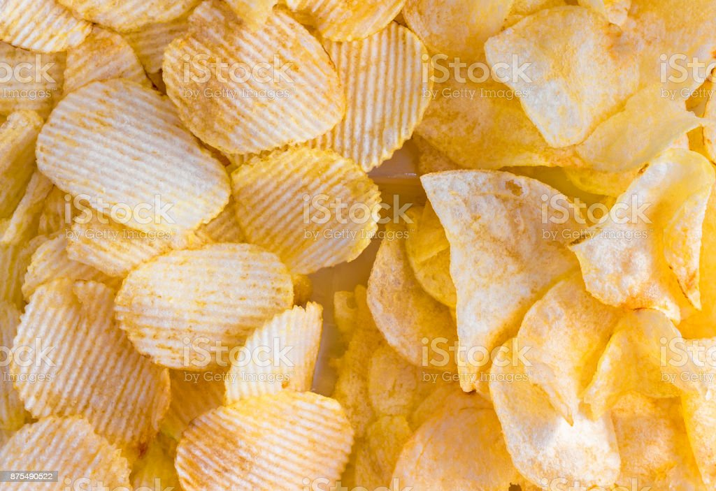 Potato chips on white background. stock photo