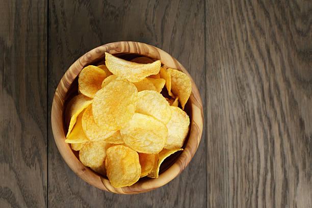 potato chips with paprika stock photo