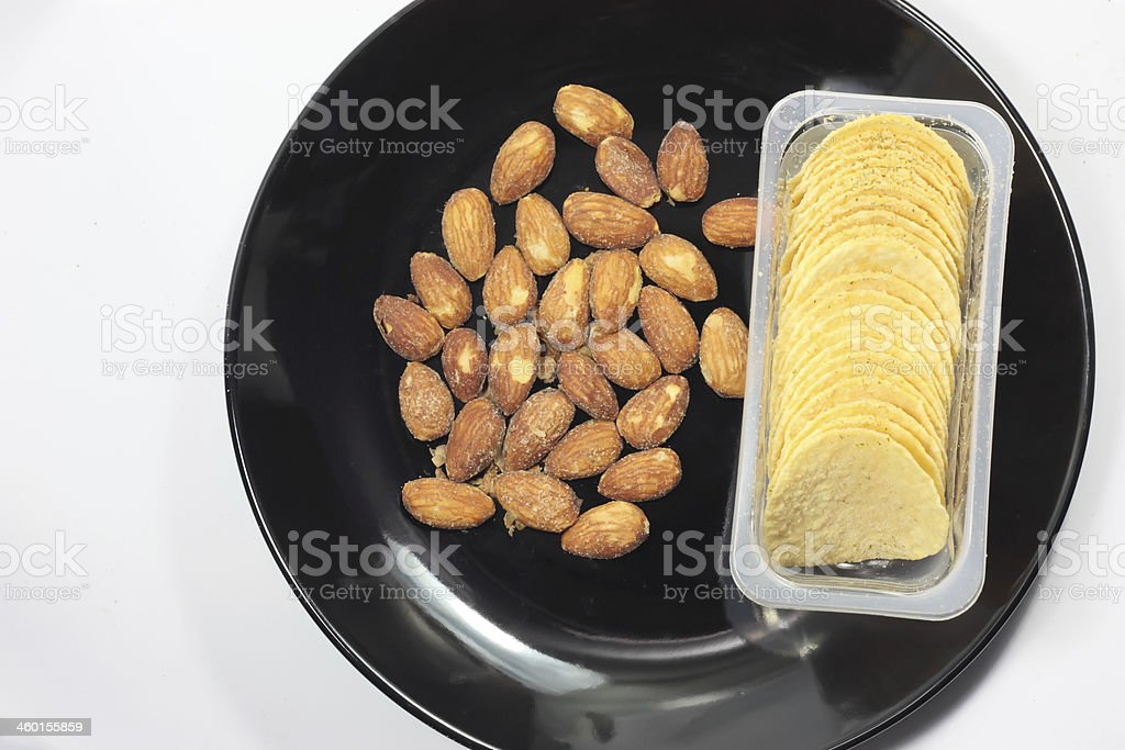 Potato chips with roasted almond isolated stock photo