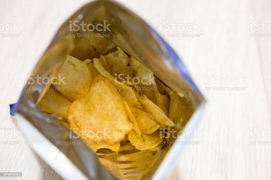 Potato crisps in package stock photo