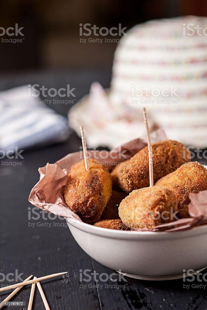 Potato Croquettes in a white bowl stock photo