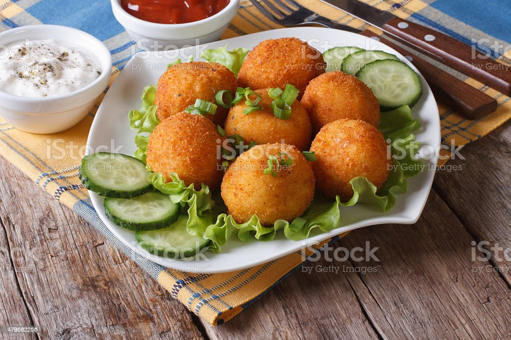 potato croquettes with lettuce and cucumber horizontal stock photo