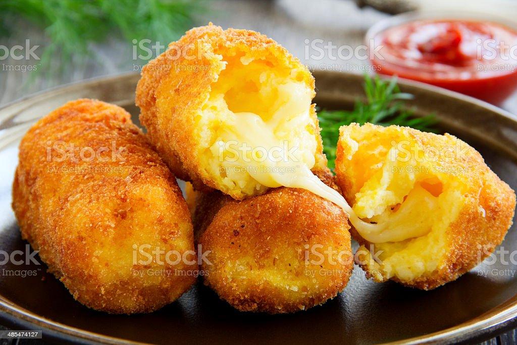 Potato croquettes with mozzarella. stock photo