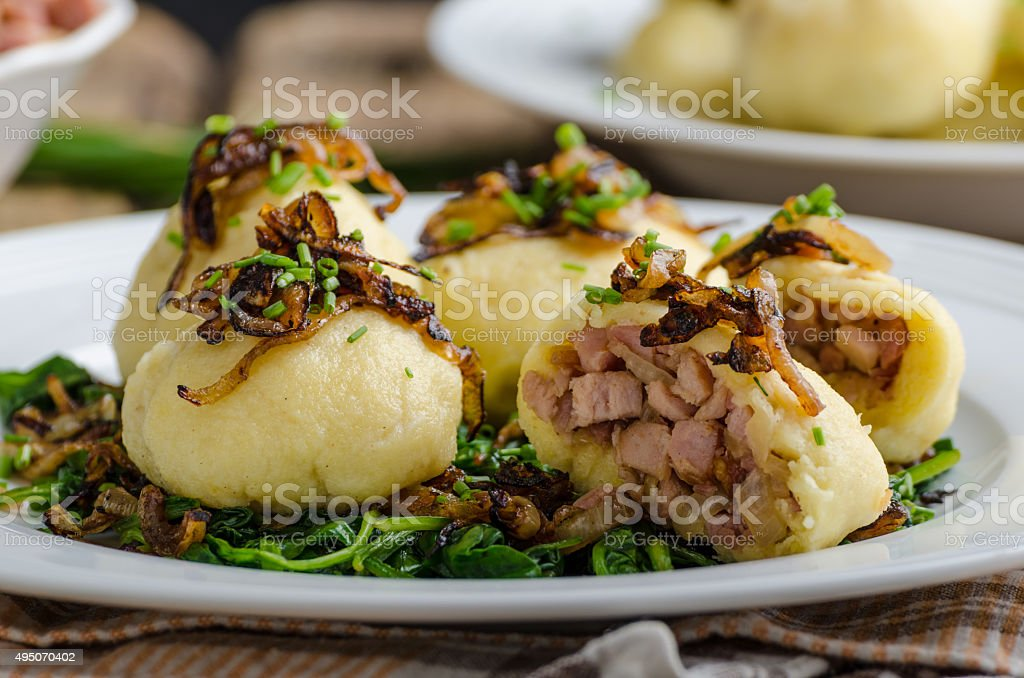 Potato dumplings stuffed with smoked stock photo