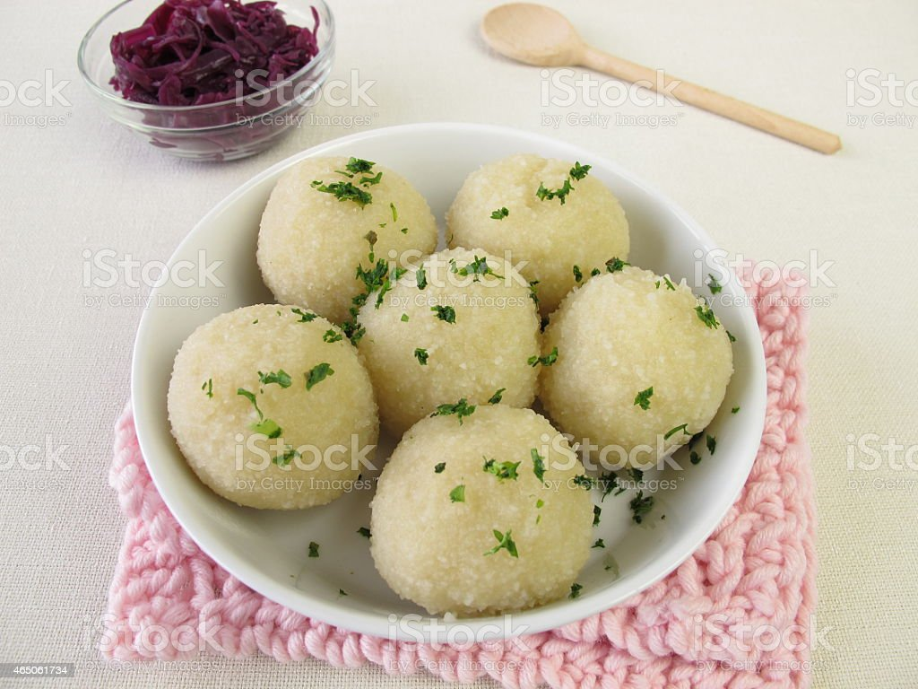 Potato dumplings with red cabbage stock photo