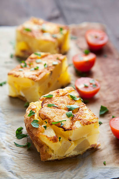 potato frittata with tomatoes and parsley raw - tortilla stock photos and pictures