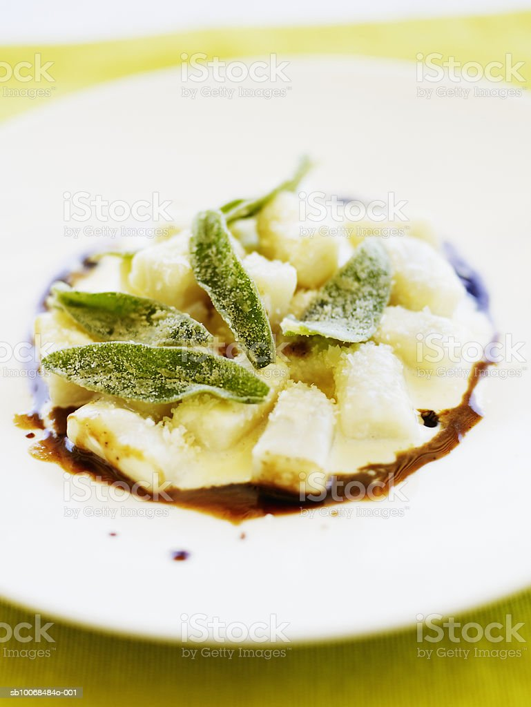 Potato gnocchi with fried sage leaves, parmesan and butter vinaigrette , close-up royalty free stockfoto