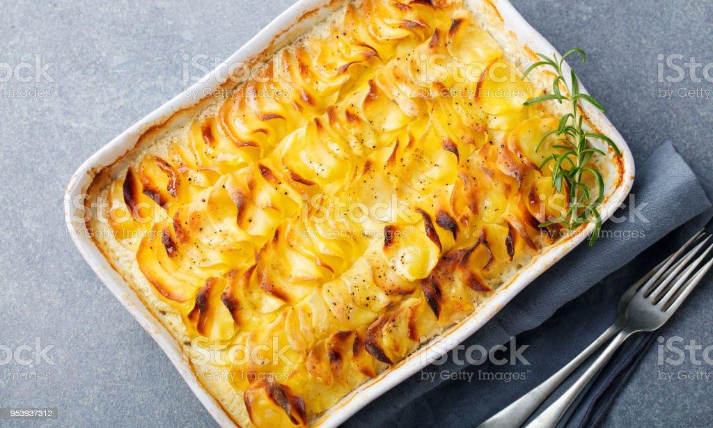 Potato gratin, backed potato slices with creamy sauce. Top view stock photo