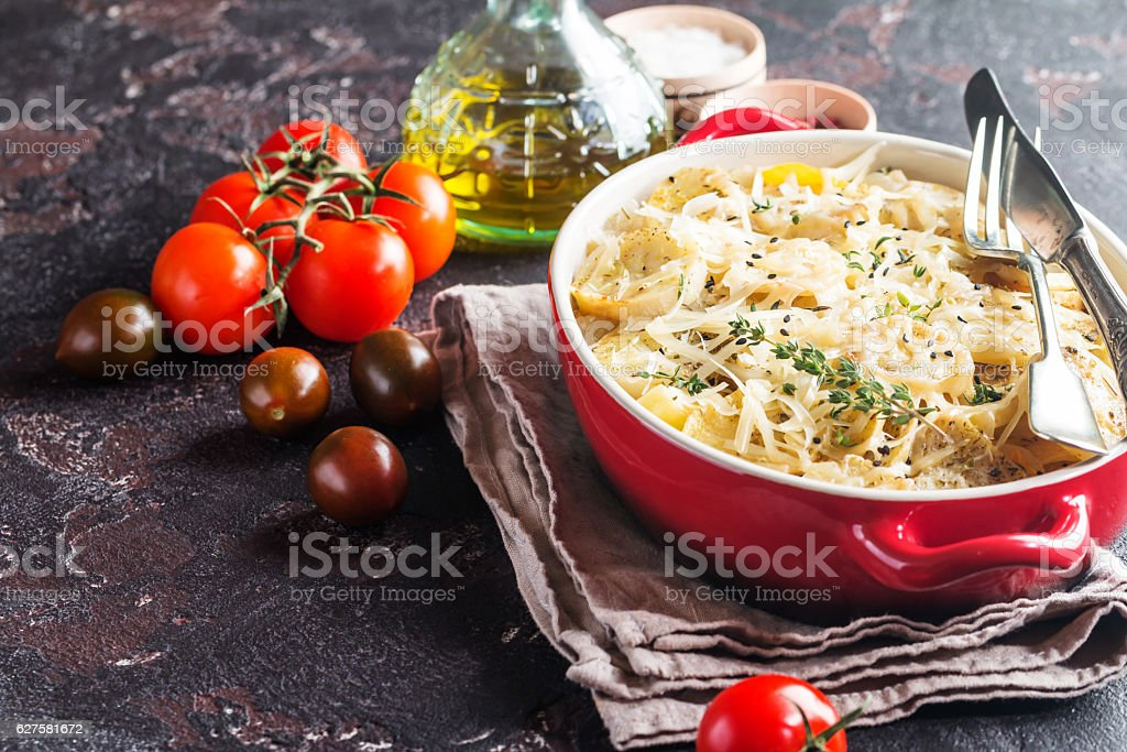 Potato gratin, in rustic dish. stock photo