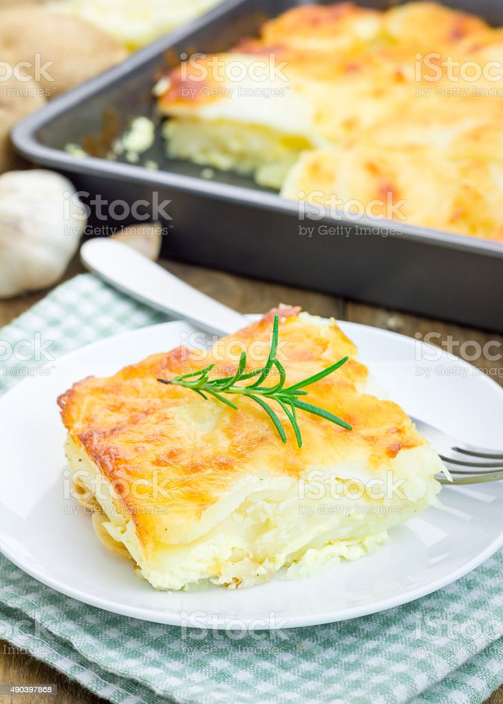 Potato gratin on a white plate stock photo