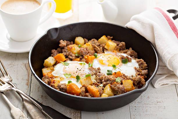 Potato hash with eggs stock photo