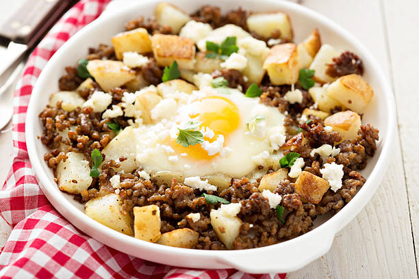 Potato hash with sausage and fried egg stock photo