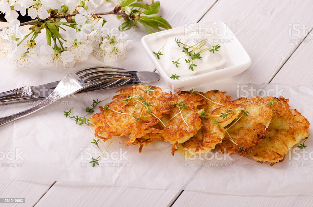 Potato pancake with sauce stock photo